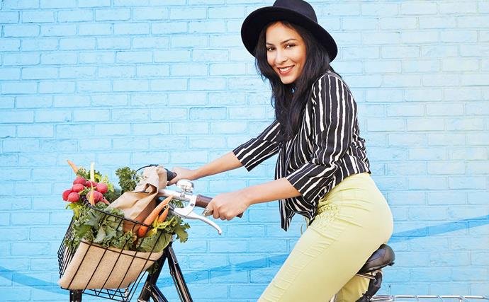 woman riding a bike with blue wall background
