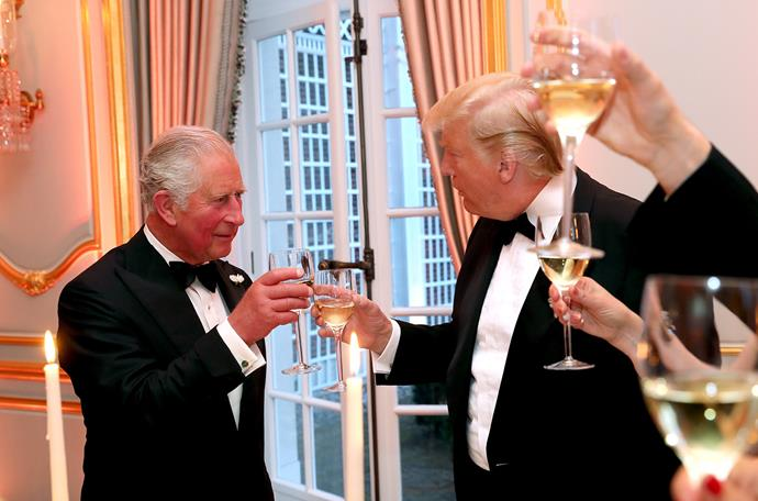 Prince Charles and President Trump share a toast at Tuesday's dinner. *(Image: Getty)*