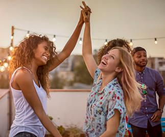 friends dancing on rooftop
