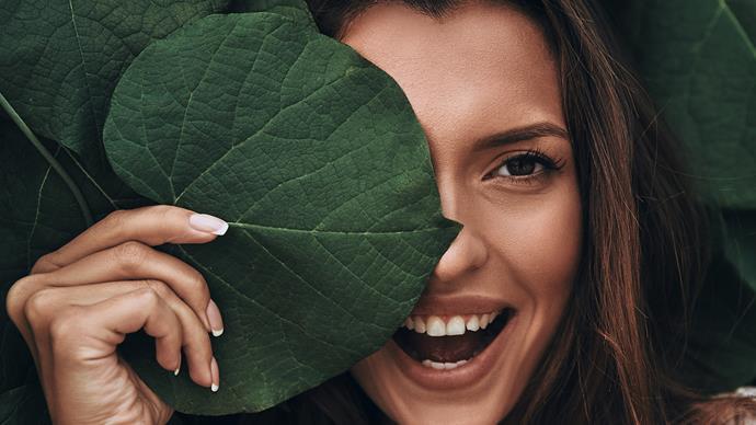 woman beauty shot behind leaf