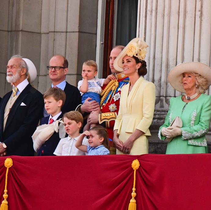 While the rest of the royal family were entranced by the fly-over, Prince George on the other hand, didn't look so sure. *(Image: Getty)*