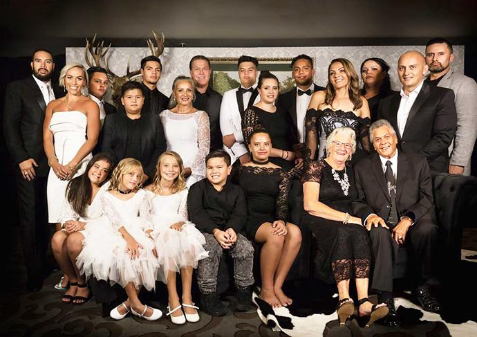 The whanau-focused couple with their loved ones, including Hannah's daughter Jasmine (back, third from right) and Brian's parents Margaret and Duke (seated, far right).