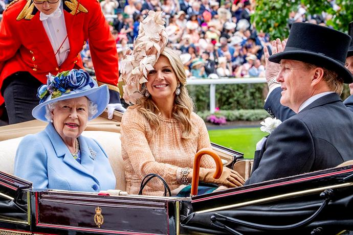 Queen Elizabeth arriving at Royal Ascot with the King and Queen of the Netherlands. *(Image: Getty)*