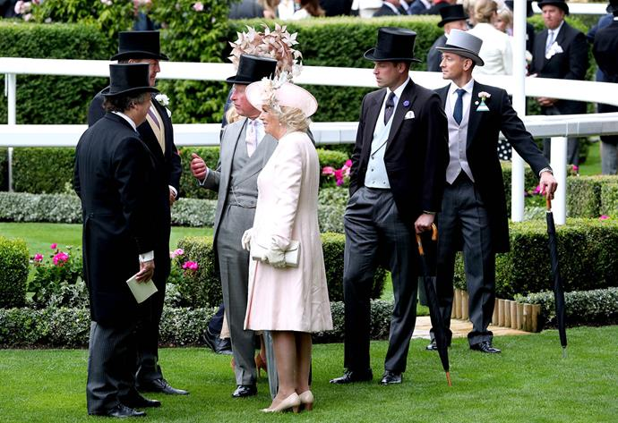 Duchess Camilla looked pretty in pink among a sea of grey and black worn by the men. *(Image: Getty)*