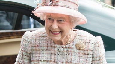 Mike Tindall makes the Queen laugh when he reveals what's hiding under his top hat