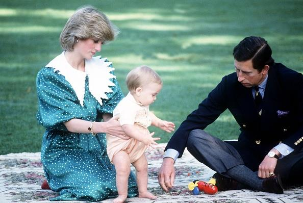 10-month-old Prince William plays with a Buzzy Bee on the lawn of Government House in Wellington, 1983. *(Image: Getty)*