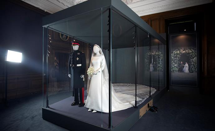 Meghan and Harry's wedding day attire is currently on display in at the Palace of Holyroodhouse in Scotland. *(Image: Getty)*