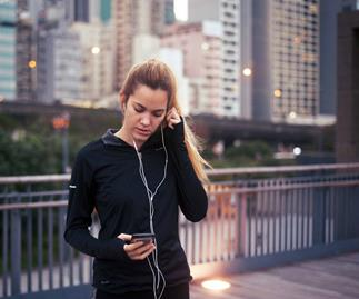 woman running with headphones