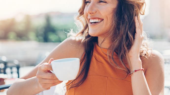 woman drinking coffee happy