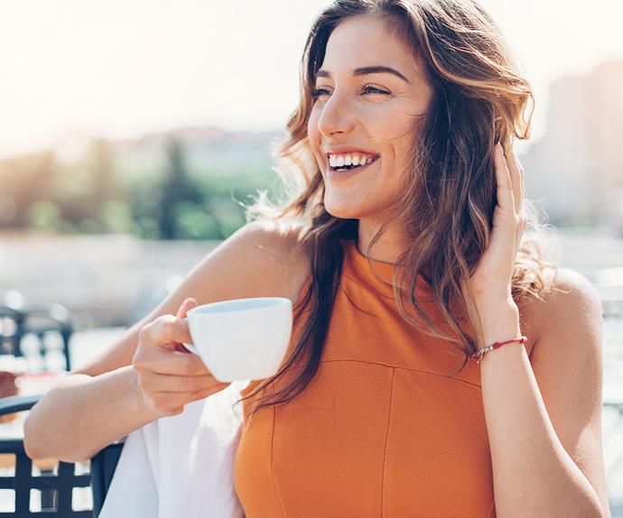 woman drinking coffee happy