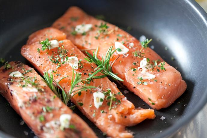 Oily fish like salmon can help balance blood sugar and reduce inflammation, both of which help regulate metabolism. *(Image: Getty)*