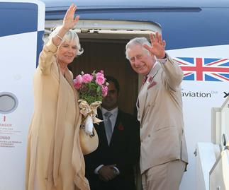 prince charles and camilla getting on a plane