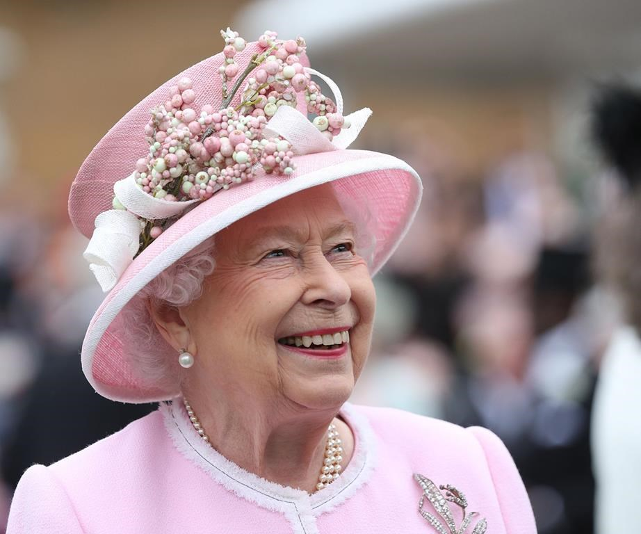 The Queen at one of her garden parties last year. *(Image: Getty)*