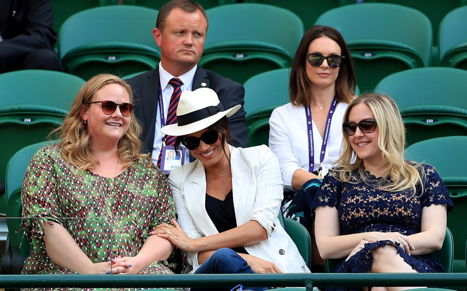 Meghan looked like she was having a grand old time with two of her closest pals Genevieve (L) and Lindsay (R). *(Image: Getty)*