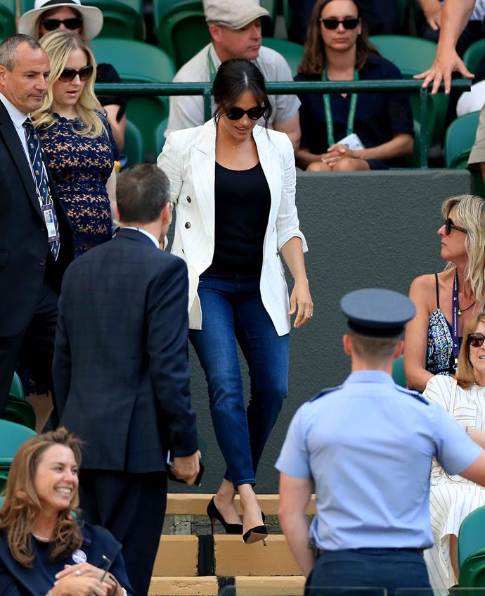 Meghan looked her characteristically stylish self to attend her good friend's second-round match on Thursday. *(Image: Getty)*