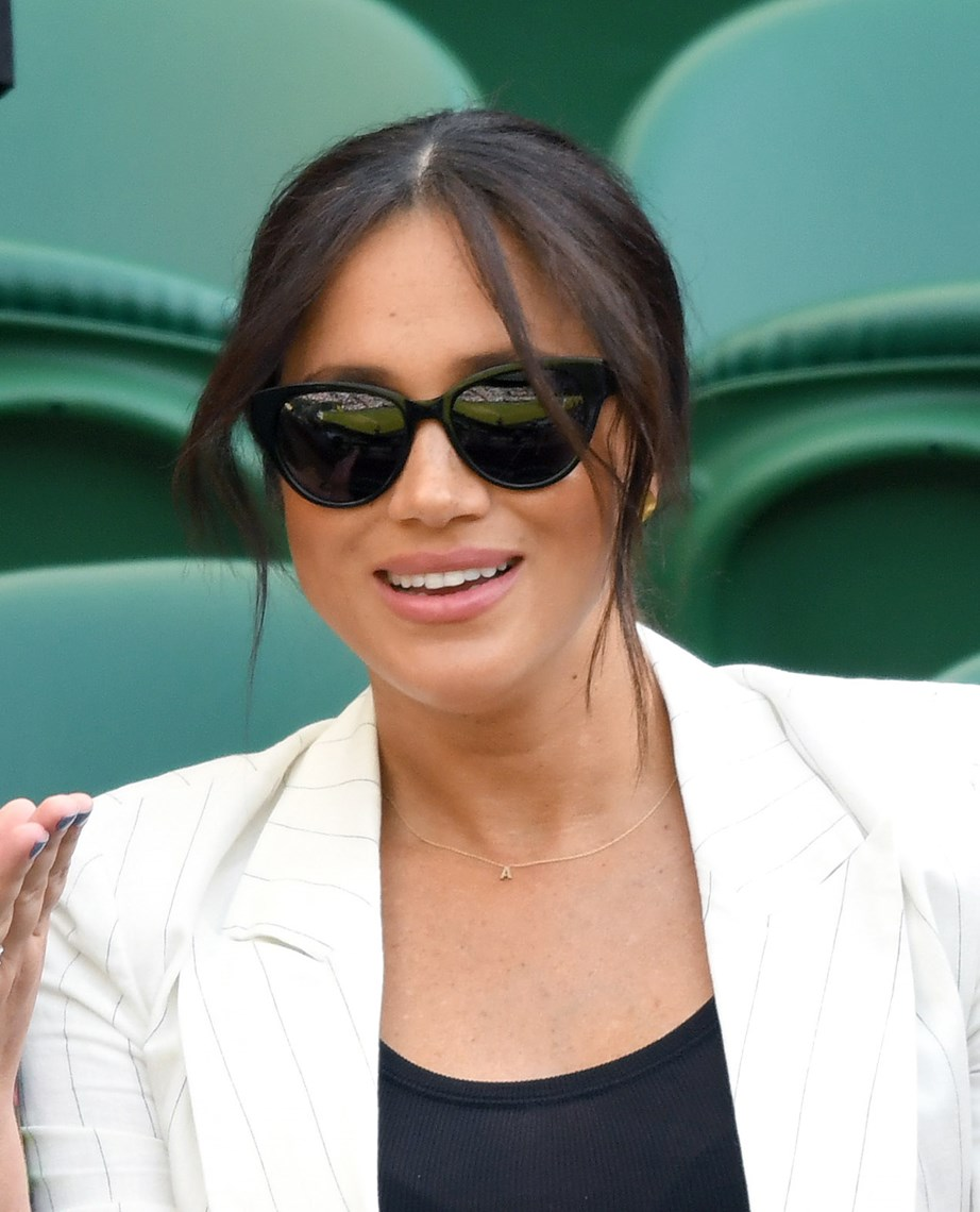 The Duchess has sparked debate about whether her appearance at Wimbledon can be considered 'private'. *(Image: Getty)*
