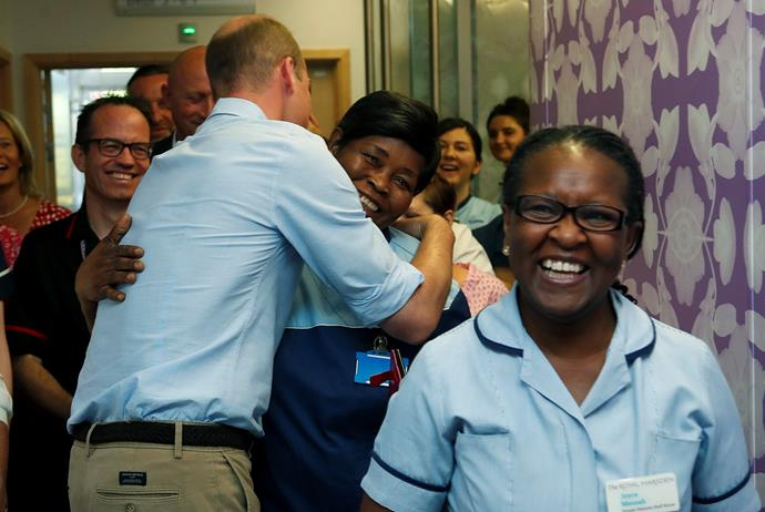 The hospital staff were beaming after receiving a hug from none other than the Duke of Cambridge himself. *(Image: Getty)*
