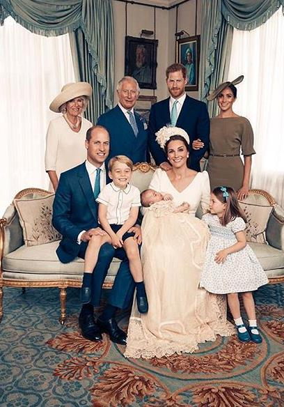 Meghan and Harry in the official portraits from Prince Louis' christening this time last year. *(Image: Matt Holyoak /@KensingtonPalace)*