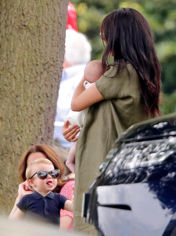 Cheeky Louis sticks out his tongue at his cousin Archie. *(Image: Getty)*