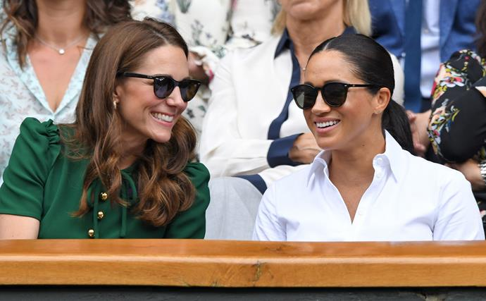 kate middleton and meghan markle smiling at wimbledon 2019