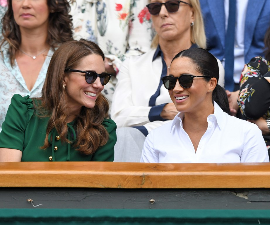 The Duchesses were all smiles at Wimbledon on Saturday. *(Image: Getty)*