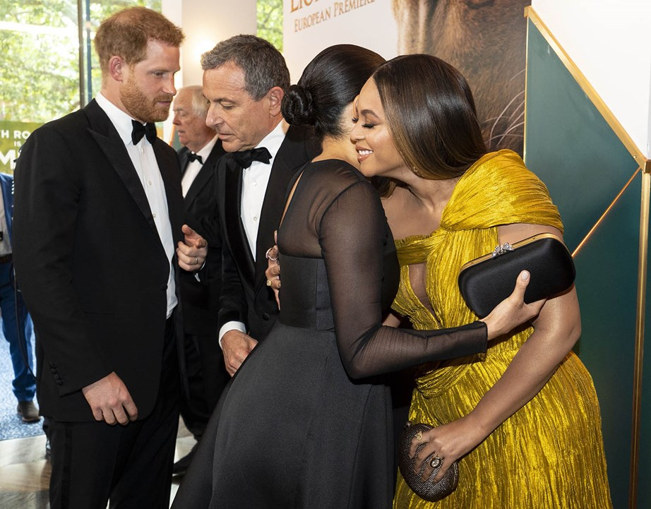 The Duchess and Beyoncé  share a hug as they meet on the red carpet of *The Lion King* premiere. *(Image: Getty)*