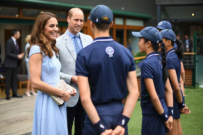Kate and William meeting with ballboys and ballgirls ahead of the finals match. *(Image: Getty)*