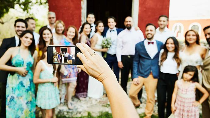 A wedding photographer has sparked heated debate after urging wedding guests to put away their phones