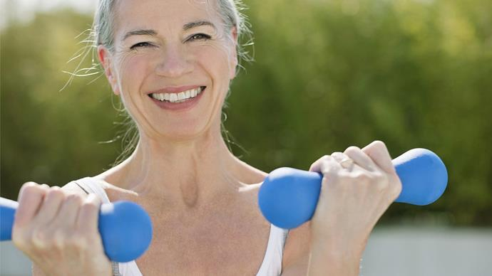 middle aged woman doing hand weights