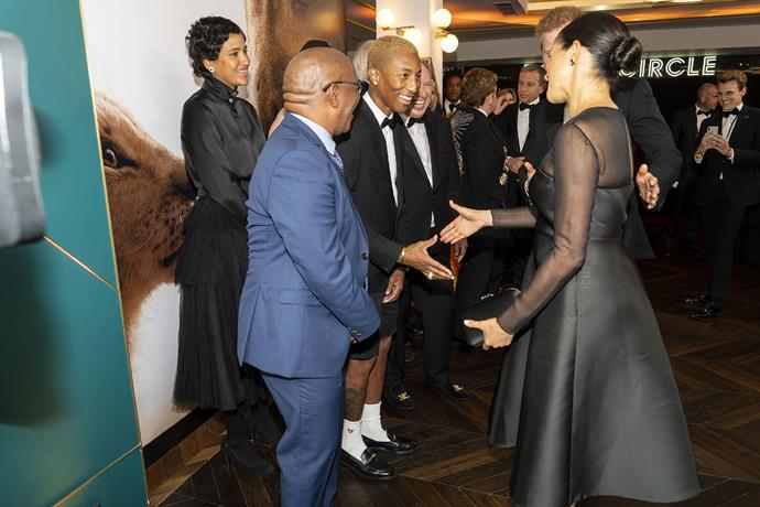 "Pharrell Williams called Meghan and Harry's relationship ""significant"" while meeting them at *The Lion King* premiere. *(Image: Getty)*"