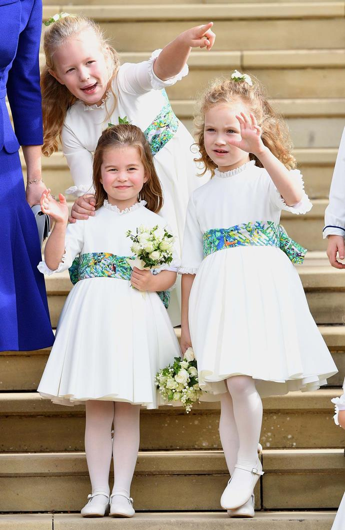 Maud Windsor (far right) with her royal relatives Savannah Phillips and Princess Charlotte who were bridesmaids at Princess Eugenie and Jack Brooksbank's wedding last year in October. *(Image: Getty)*
