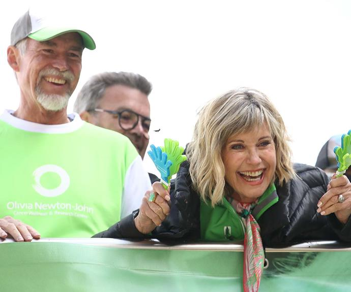 Olivia Newton-John and her husband John Easterling at the Wellness Walk and Research Run in 2018 in Melbourne. The annual event raises vital funds to support cancer research and wellness programmes at the Olivia Newton-John Cancer Wellness and Research Centre in Victoria.   *Image: Getty*