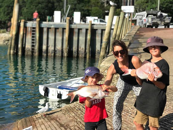 Sam's sons, Ari (left) and Zephyr, are more likely to be out fishing for dinner than playing on digital devices.