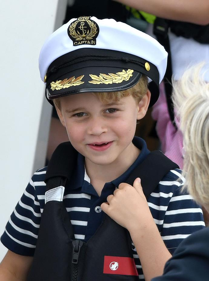 Prince George was dressed for the nautical event in his blue-and-white-striped shirt and captain's hat! *(Image: Getty)*