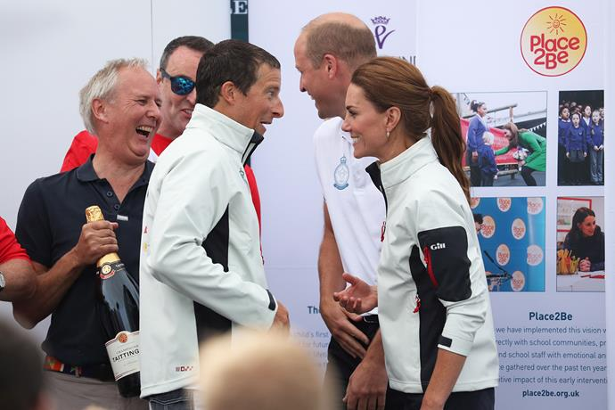 Bear Grylls and Kate share a laugh - perhaps about Prince George? *(Image: Getty)*