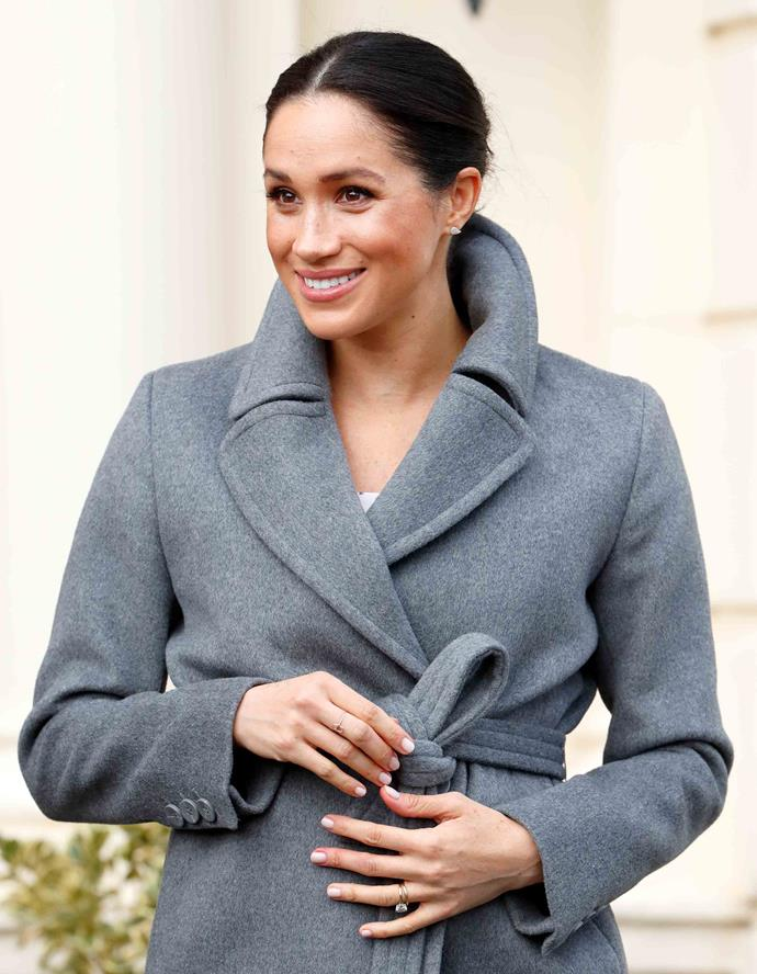 Look closely and you'll spot the same Hamsa Ring on Meghan's right middle finger during her visit to Royal Variety Charity's nursing home in December 2018. *(Image: Getty)*
