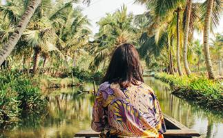 paddling canoe down river southeast asia