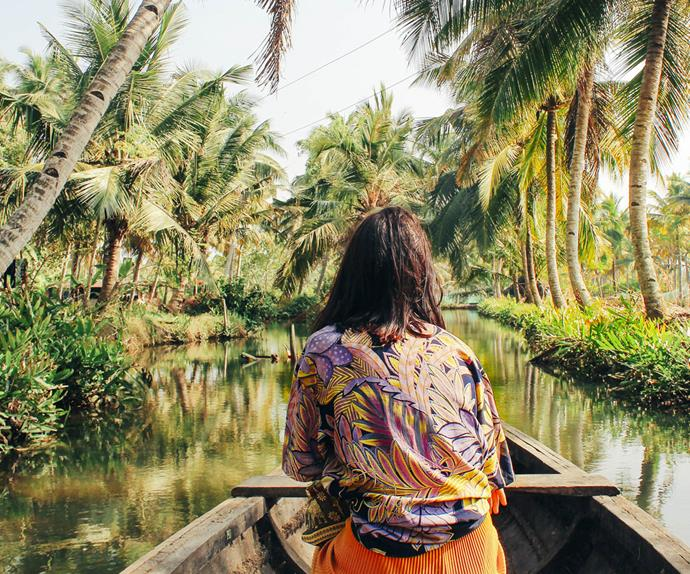 paddling canoe down river southeast asia