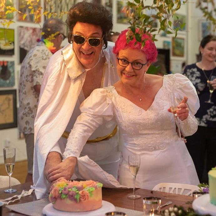 """David and Katherine renewed their wedding vows in a mass vow renewal ceremony with their friends in July. David was the celebrant so naturally he dressed as Elvis. Katherine wore her original wedding dress and dyed her hair pink because pink """"went better with the dress than grey hair!"""""""