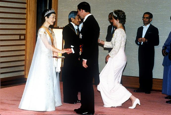 Prince Charles and Princess Diana are welcomed by (now former) Emperor Akihito and Empress Michiko in 1990. *(Image: Getty)*
