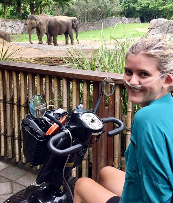 Makena takes a trip to the zoo with oxygen and a mobility scooter.