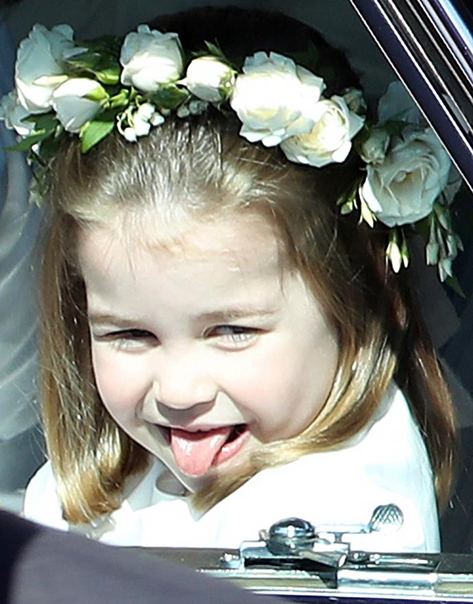"**Princess Charlotte, May 2018** <br><br> She [stole the show as a member of the Duke and Duchess of Sussex's bridal party](https://www.nowtolove.co.nz/celebrity/royals/prince-george-and-princess-charlotte-steal-the-show-at-the-royal-wedding-1-37827|target=""_blank"") in May and perhaps it was this priceless snap of Princess Charlotte that made it all the more iconic. Dressed in an ivory Givenchy dress complete with a flower crown, the youngster went off-script for a split second as she made her way to the ceremony. <br><br> *(Image: Getty)*"