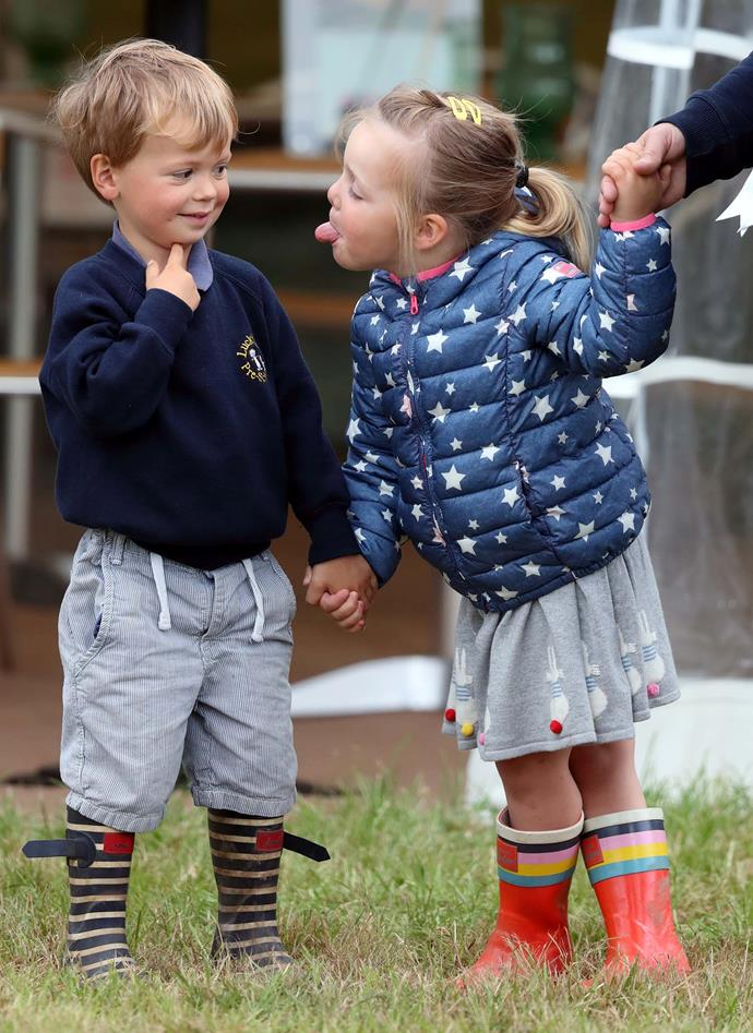 **Mia Tindall, September 2017** <br><br> Showing she's clearly inherited the fun-loving personalities of her parents Zara and Mike Tindall, little Mia pokes out a tongue at her friend Charlie Meade - who is the son of event rider Harry Meade - as they attend the Whatley Manor Horse Trials at Gatcombe Park. <br><br>  *(Image: Getty)*