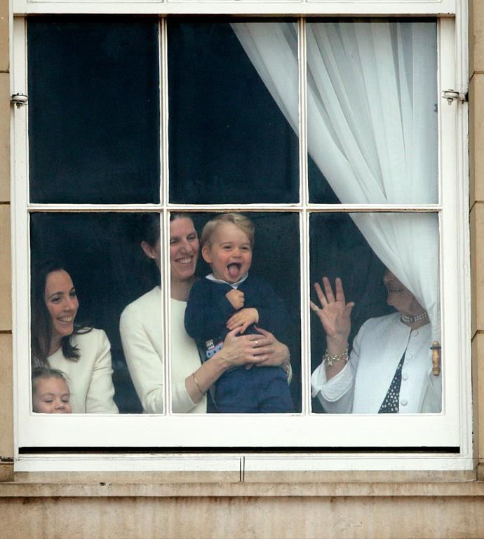 "**Prince George, June 2015** <br><br> The annual Trooping the Colour is known for providing a whole bunch of delightful moments, particularly when it comes to the littlies and 2015 was no different. Prince George marked his first public celebration of his great-grandmother's birthday by wagging his tongue out the window of Buckingham Palace - which also marked the start of some iconic images of [George peering through windows](https://www.nowtolove.co.nz/celebrity/royals/prince-george-best-moments-looking-through-windows-38534|target=""_blank"") too. <br><br> *(Image: Getty)*"