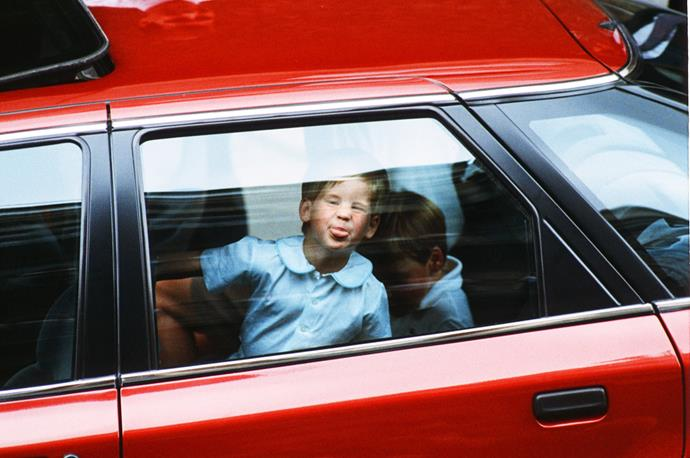 **Prince Harry, August 1988** <br><br> And just months later, at almost four years old, Harry was back at it again. This time through a car window! He had just visited his aunt Sarah Ferguson and his newborn cousin Princess Beatrice at the hospital with his older brother Prince William and mother Princess Diana. <br><br> *(Image: Getty)*