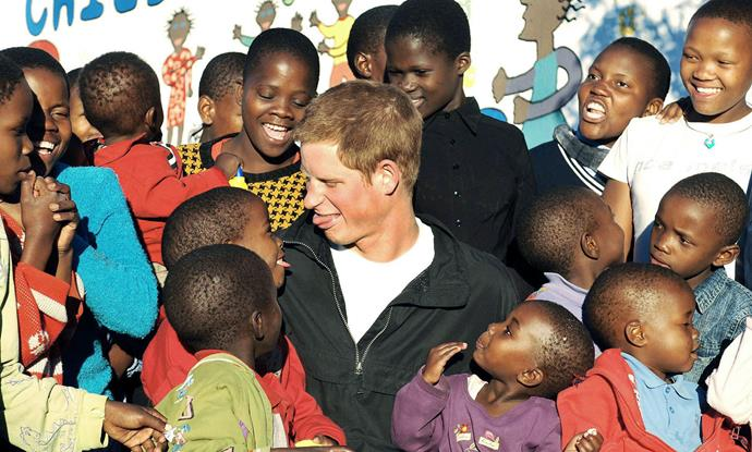 "**Prince Harry, April 2006** <br><br> Proving that into adulthood he's still the same fun-loving Prince, Harry was seen joking with children during a visit to Lesotho in southern Africa, to [launch his charity Sentebale](https://www.nowtolove.co.nz/celebrity/royals/the-royal-family-unseen-photos-of-prince-harry-in-africa-38544|target=""_blank""). <br><br>  *(Image: Getty)*"