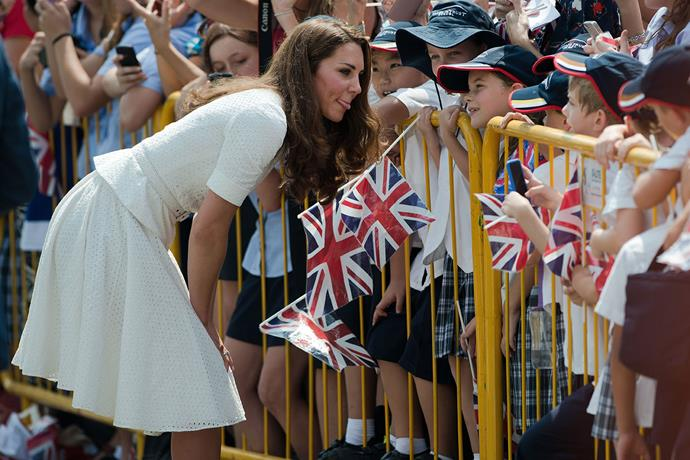 **Duchess Catherine, September 2012** <br><br> Of course the Cambridge children's mother Kate is known to be fantastic with children and a good laugh, which is perfectly on display here as she greets school children during a royal tour to Singapore. <br><br> *(Image: Getty)*
