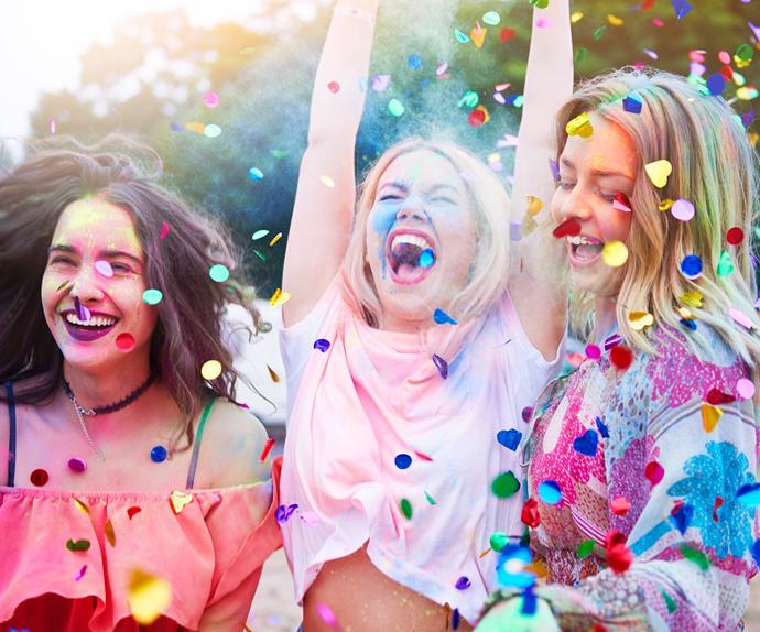 Group of three friends laughing confetti