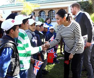meghan markle and prince harry greet children in morocco
