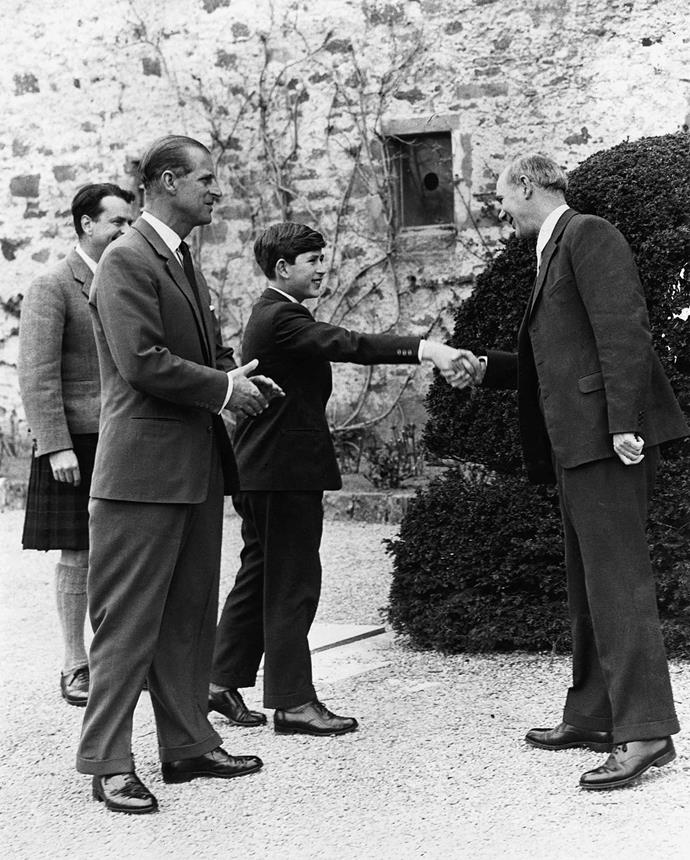 **Prince Charles, 1962** <br><br> A young Prince Charles shakes hands with her new headmaster on his first day at Gordonstoun School in Scotland. He's here with his father, the Duke of Edinburgh, who also attended the school. <br><br> *(Image: Getty)*